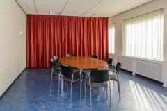 Rode zaal 12 zitplaatsen